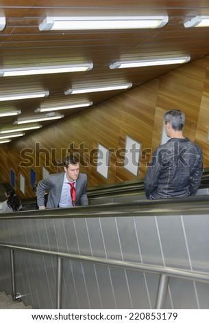 Running up an escalator going down - stock photo