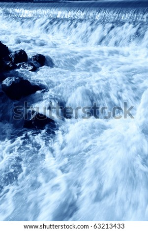 running water in a drainage gate - stock photo
