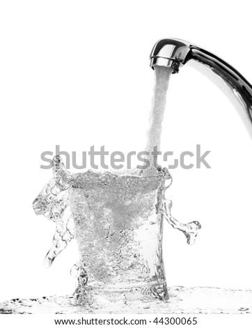 running water into a glass-wastewater cocept - stock photo