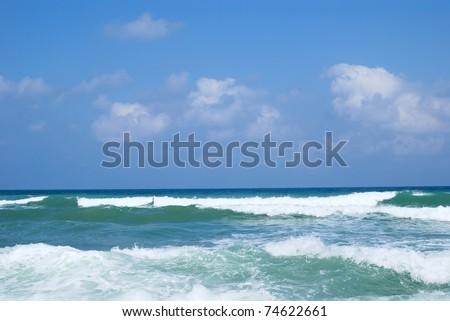 Running waves under the blue sky. Mediterranean sea. - stock photo