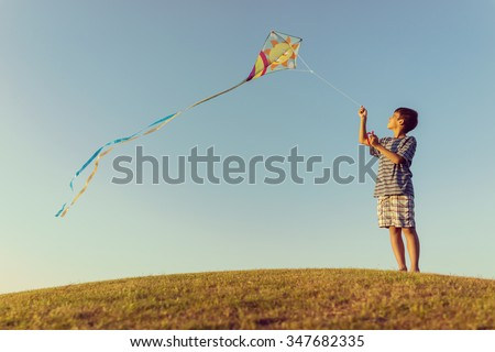 Running with kite on summer holiday vacation, perfect meadow and sky on seaside