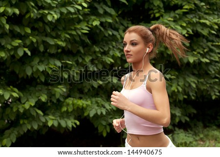 Running woman. Female runner jogging during outdoor - stock photo