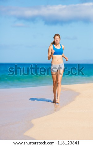 Running woman. Female runner jogging during outdoor workout on beach. Beautiful Fitness Model Outdoors. - stock photo