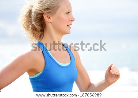 Running woman healthy lifestyle. Female runner jogging training outdoors on beach. Happy fit jogger living healthy lifestyle training outside. - stock photo
