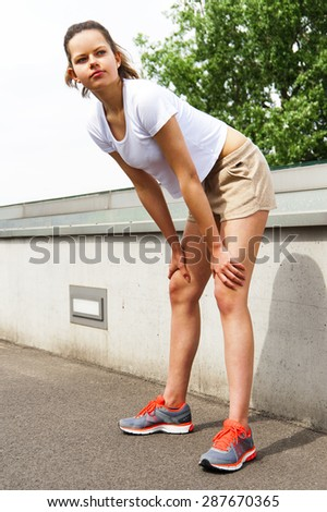 Running woman. Runner jogging in sunny bright light. Female fitness model training outside in  City with skyline. - stock photo