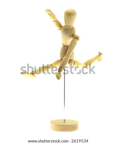 Running wood mannequin on a white background