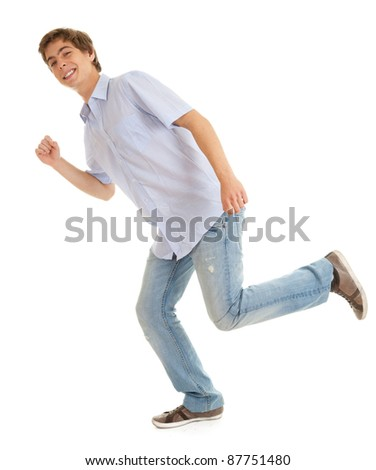 running young man  in bright shirt, white background - stock photo