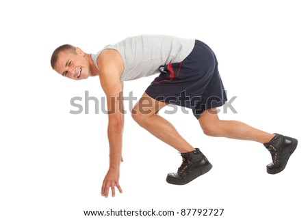 running young man in sport cothes, white background