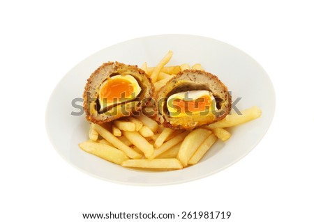 Runny yolk scotch egg and chips in a bowl isolated against white - stock photo