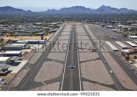 Runway and aircraft at Scottsdale Airport - stock photo