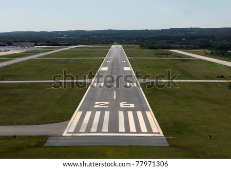 Runway approach at a rural airport in the eastern United States. - stock photo