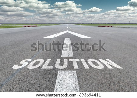 Runway of airport with arrow guideline and solution letters painted on the surface