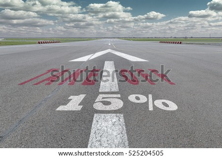 Runway of airport with arrow guideline, take off and 15 percent sign printed on the asphalt