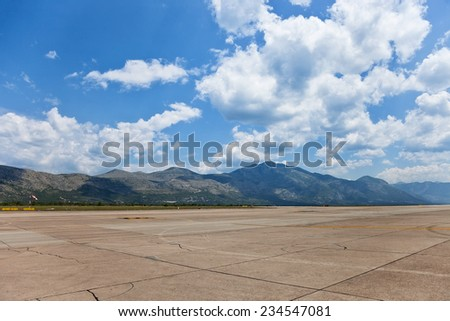 Runway of Dubrovnik Airport on a background of mountains.  - stock photo