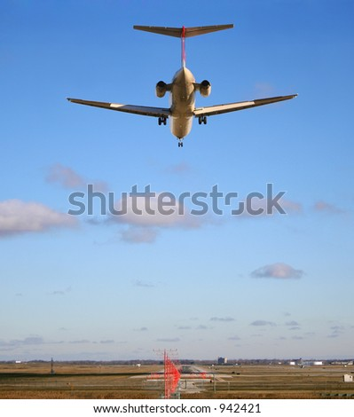 Runway stretches out ahead of jet just about to land - stock photo