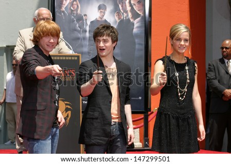 Rupert Grint, Daniel Radcliffe, and Emma Watson at Harry Potter Handprint/Footprint/Wandprint Ceremony Grauman's Chinese Theater Los Angeles, CA July 9, 2007 - stock photo
