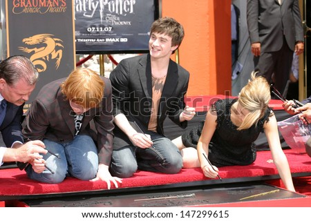 Rupert Grint, Daniel Radcliffe, and Emma Watson at the Harry Potter Handprint/Footprint/Wandprint Ceremony Grauman's Chinese Theater Los Angeles, CA July 9, 2007 - stock photo