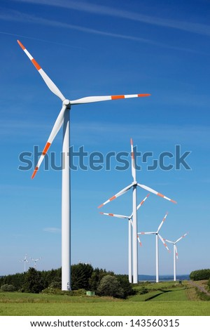 Rural area wind enegy producing wind turbines - stock photo