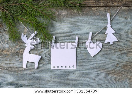 Rural background, festive decorations, decor, home decoration,  heart, white, deer,  Chrismass tree, wood texture. Decor made of cardboard. Rustic background. Decorative toy on a rope, a sprig of fir. - stock photo