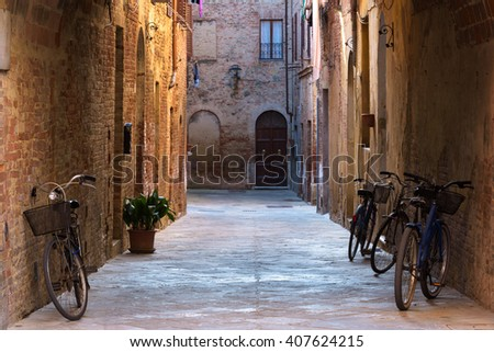 Rural bikes on the streets of the beautiful medieval town in Tuscany. - stock photo