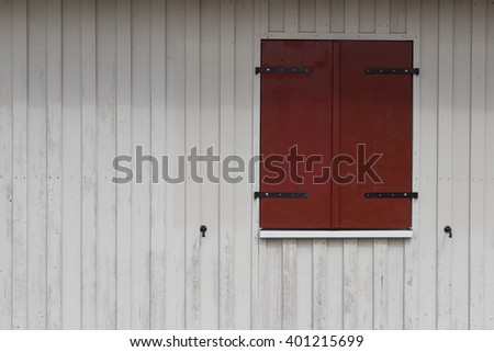 rural building exterior,  wooden shutters on wooden wall