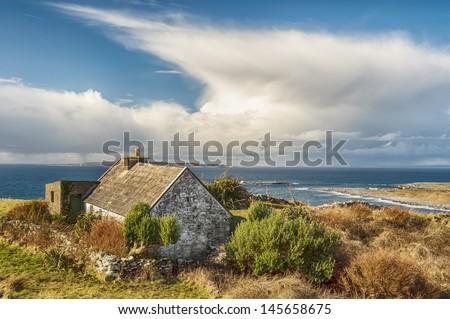 rural cottage in a scenic irish landscape - stock photo