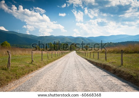 Rural Dirt Road Farm Landscape in Cades Cove TN through summer hay fields