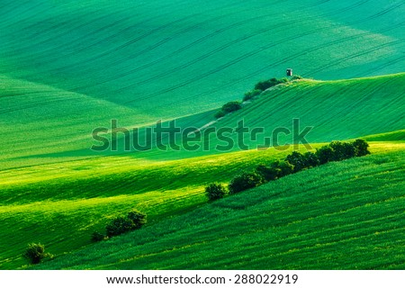 Rural Europe background - Moravian rolling landscape with hunting tower shack on sunset. Moravia, Czech Republic - stock photo