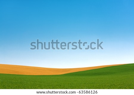 Rural Farm Field Contours and Sky - stock photo