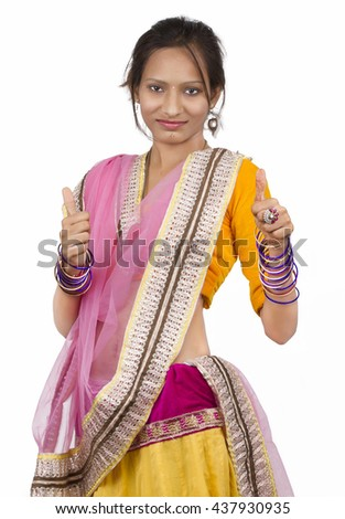 Rural Girl gesturing thumbs against white background