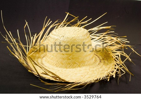 Rural hat in black background - stock photo