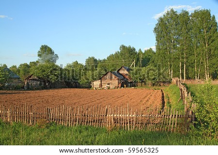 rural house near plow field