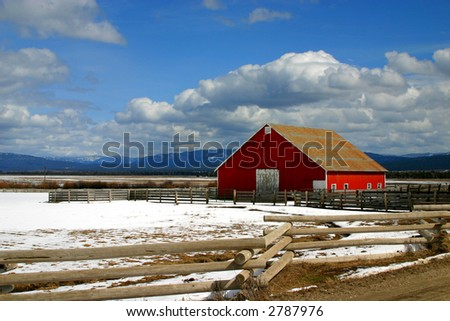 Rural Idaho red barn in early winter - stock photo