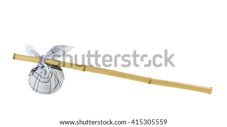 Rural knapsack on a bamboo pole isolated on white background