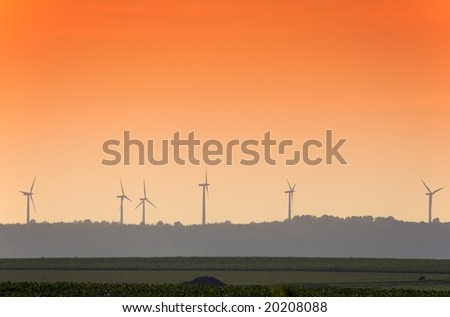 Rural landcsape with wind turbines at sunset