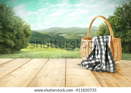rural landscape and basket and blue napkin  - stock photo