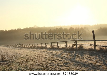 Rural landscape at sunrise on a cold November day. - stock photo