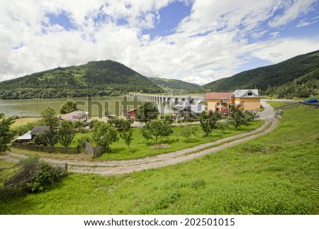 rural landscape in Romania with Bicaz lake and viaduct - stock photo