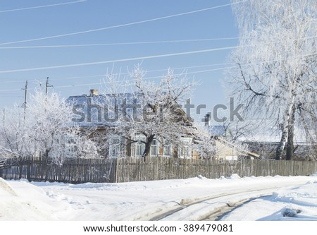 Rural landscape in winter on background blue sky in Russia