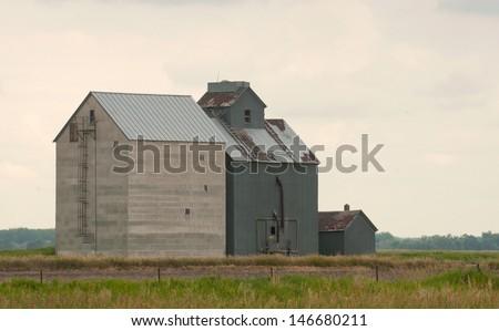 Rural landscape: old-fashioned rural grain elevator in North Dakota - stock photo