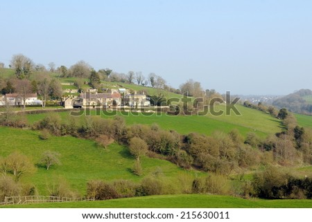 Rural Landscape View of Green Fields and Small Village in the Avon Valley near the City of Bath on the Wiltshire Somerset Border in England - stock photo