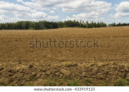 Rural Landscape  with a Beautiful Blue Cloudy Sky Above. - stock photo