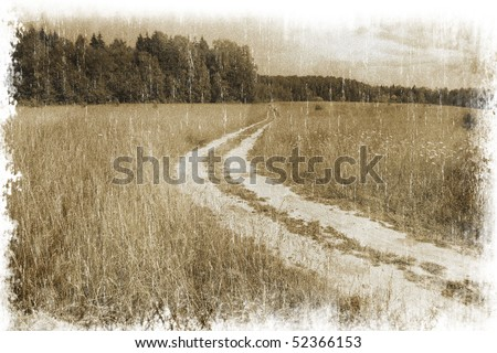 Rural landscape with a road across the field (vintage style) - stock photo