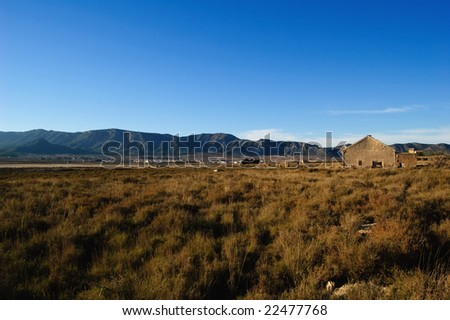Rural landscape with abandoned factory - stock photo