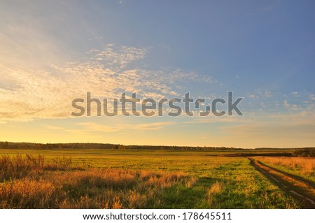 Rural landscape with beautiful sunset light - stock photo