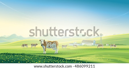 Rural landscape with cows and farm with mountain scenery in background.