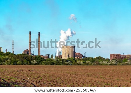 Rural landscape with factory outdoors
