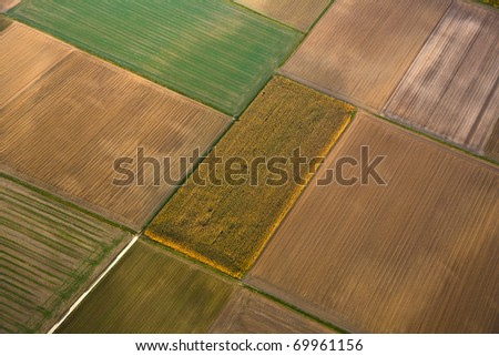 rural landscape with fields in indian summer light from hot air balloon - stock photo