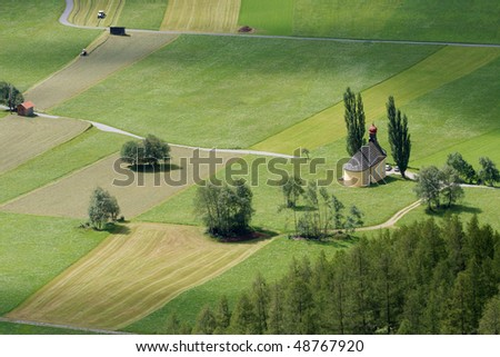 Rural landscape with green fields viewed from above - stock photo