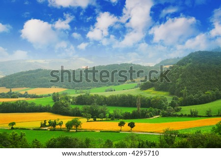Rural landscape with hills and mountains in eastern France - stock photo